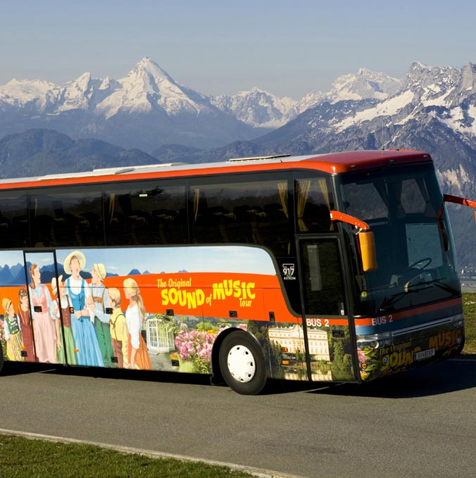 Sound of Music Tourbus in front of the mountains